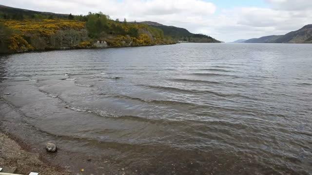 Loch ness Scotland uk popular tourist attraction Fort Augustus Scottish Highlands pan video
