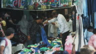 Locked-on shot of people at market stall, Delhi, India video