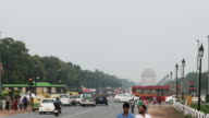 Locked-on shot of traffic on city road, India Gate, New Delhi, India video