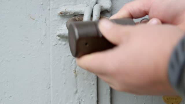 Locking padlock on metal gates video