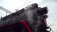 Locomotive Under Steam on Siding. Concept - Symbol of Bygone Era, alternative energy of steam video