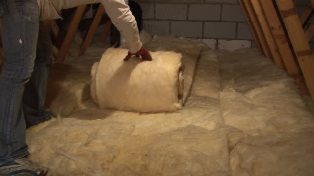 Loft / Attic Insulation being rolled out in roof space video