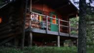 Log cabin at dusk video