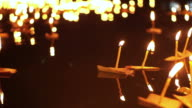 Loi Krathong Festival in Chiangmai, Thailand. Hand releasing floating decorated baskets and candles to pay river goddess respect video