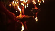 Loi Krathong Festival in Chiangmai, Thailand. Hand releasing floating decorated baskets and candle video