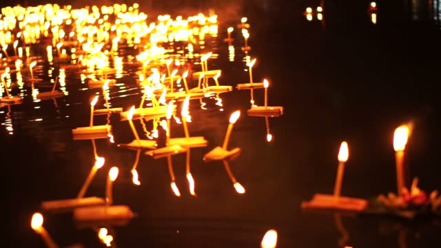Loi Krathong Festival in Chiangmai, Thailand. Thousand of floating decorated baskets and candles to pay respect to river goddess. Thai traditional culture on full moon night video