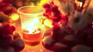 Loi Krathong festival. Selling krathong decorated with flower at night with candle video