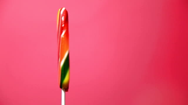 lollipop  on a red background video