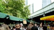 London Borough Outdoor Market Tilt Up (4K/UHD to HD) video