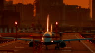 London City Airport - Ultra closeup of an airliner preparing to take off during sunset video