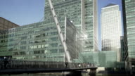 London Docklands, suspension bridge by some high rise office buildings. video