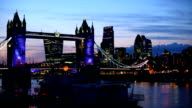 London Tower Bridge with skyline in the night video