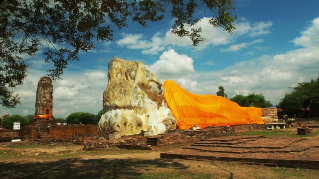 Lone Buddhist enormous statue of the Buddha at Ayutthaya Historical Park in Thailand. video