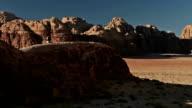 lone man walking in wadi rum, valley of the moon, jordan video