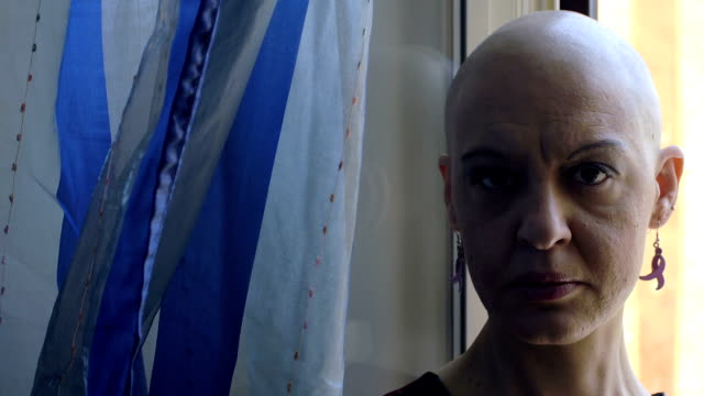 loneliness of a woman with cancer: portrait, disease, fear, chemotherapy video
