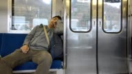 lonely and tired men in subway video