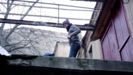 Lonely boy wandering on roof of abandoned building, transitional age video