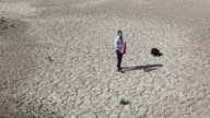 Lonely businessman is lost in desert and seek for help video