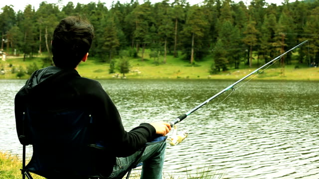 Lonely Man Fishing At The Lake video