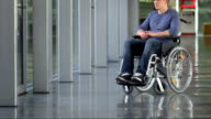 LS PAN Lonely Young Man In Wheelchair video