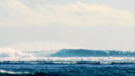 Long 15ft wave breaking along a secluded reef in Indonesia. video