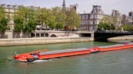 Long Industrial Barge Boat on the River Seine in Paris France video