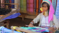 Long neck karen women weaving. video