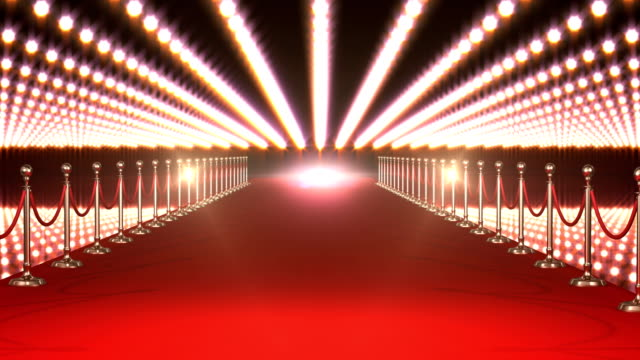 Long red carpet with spotlights against red background video