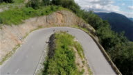 Longboard skaters speeding downhill one after another video