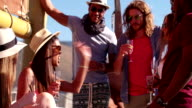 Long-haired man in sunglasses partying with friends on a yacht video