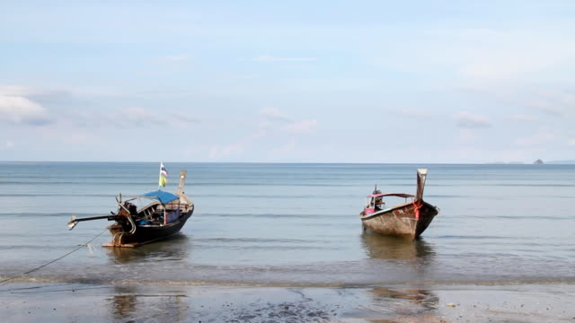 Long-tail boats on the beach. video