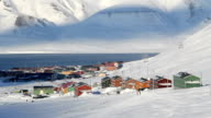 Longyearbyen, Svalbard. The small town is surrounded by mountains. A Sunny day in March. Timelapse. video