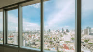 Look through the city and traffic view in Bangkok from office window video
