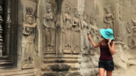 Looking at Angkor Wat apsaras video