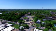 Looking at Hills high and far angle Aerial Above Austin Texas Hill Country looking down at the Castle Hill Graffiti wall with Hills , castle , and outdoor public graffiti wall in view in the air over ATX 2016 drone view close view video