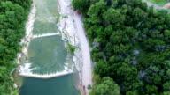Looking down on Georgetown Texas San Gabriel River sets of waterfalls video