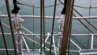 Looking down  to water through the ship rigging video