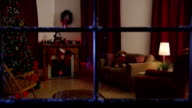 Looking in window at home decorated for Christmas video