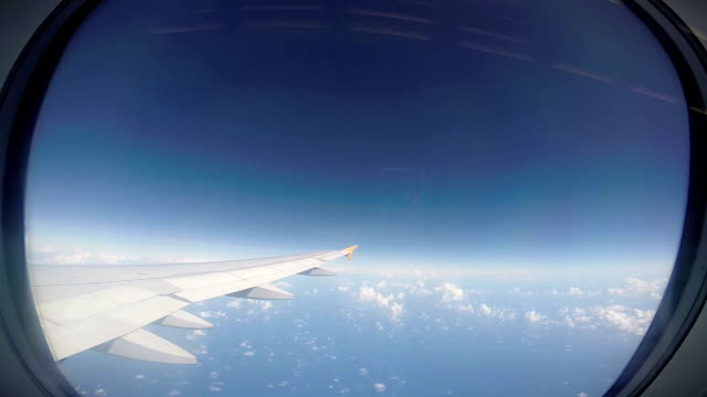 Looking Out of an Airplane Window on the engine and wing video