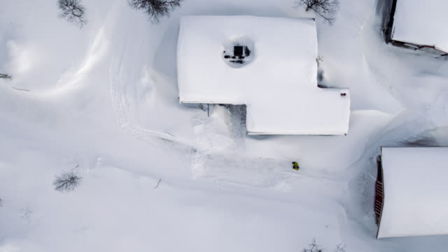 Looking straight down at isolated cabin in the snow video