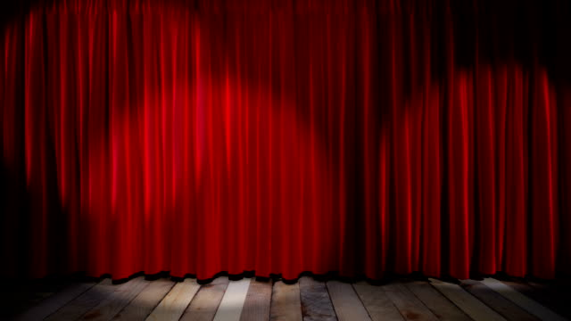 Loop light on red fabric curtain video