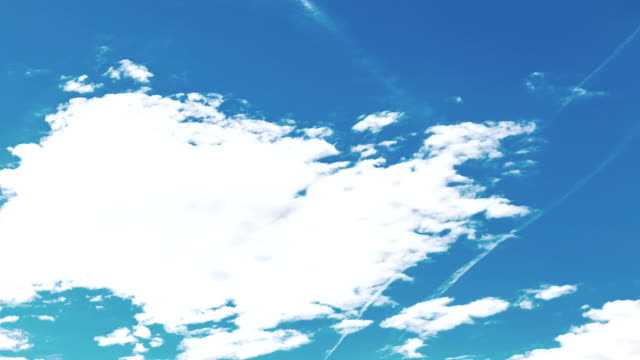 loop of white clouds over blue sky video