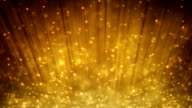loopable motion background rising gold particles video