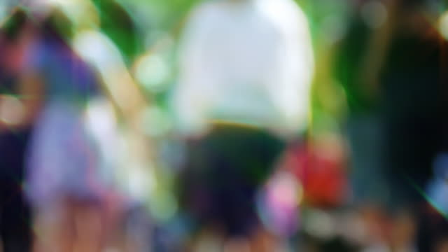 Loopable! Slow motion colorful anonymous crowd. Abstract background. video