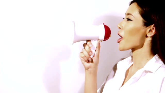 Loopable video of beautiful woman talking with megaphone v1 video