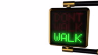 Looped animated background: 3d old-style golden street traffic light with alternately changing the words 'DONT WALK/ WALK' red and green color on the black pixels. 4k. Seamless loop. Alpha matte. video