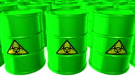 Looped animated background with acid-green barrels with  black-yellow sign of bio hazard. Toxic waste. White background. 4k. Seamless loop. video