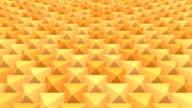 Looping background elastic grid of orange pyramids video