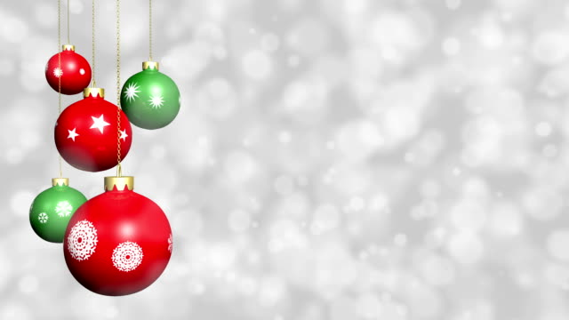 Looping Christmas ornaments with snow background. video