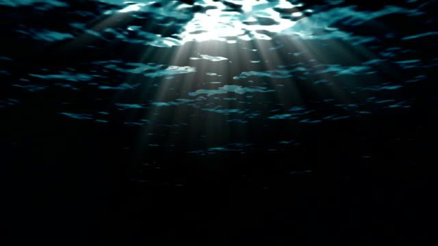 Looping ocean waves, underwater. Light rays. video